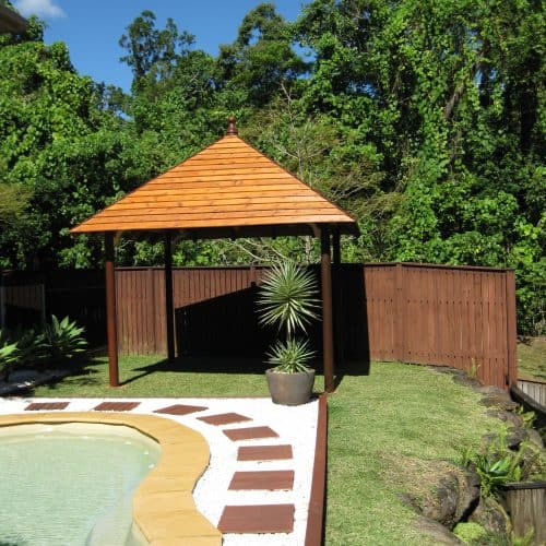 Grand Gazebos and Cubbies - 3.8m Hipped Pavilion next to pool on grass